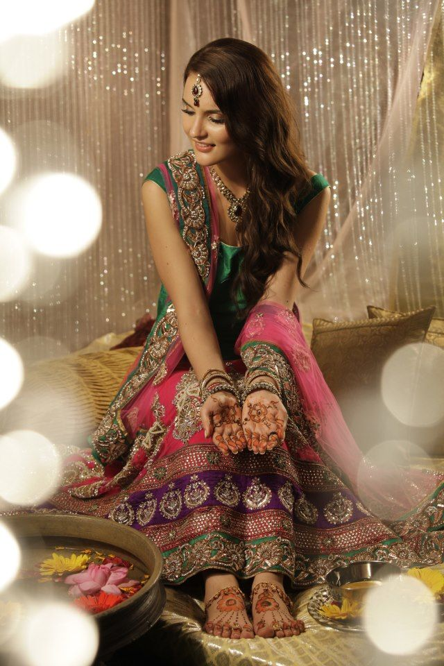 I like the idea of colorful lengha for mendhi night instead of all green