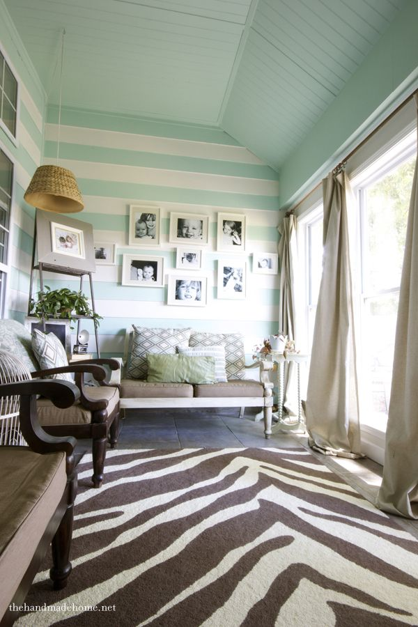 mint striped walls... maybe not so much the zebra rug.. but  i heart pastel colors in a room. adds so much light.