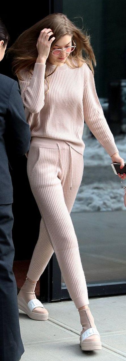 Who made Gigi Hadid's white zipper sneakers, nude ribbed top, round pink handbag, and tan sweatpants?