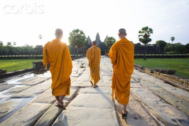 Monks walking towards temple, Angkor Wat, Cambodia