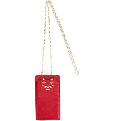 Red calf leather 'Feline' iPhone 6 case from Charlotte Olympia featuring a gold-tone cat's face and a gold-tone chain shoulder strap.