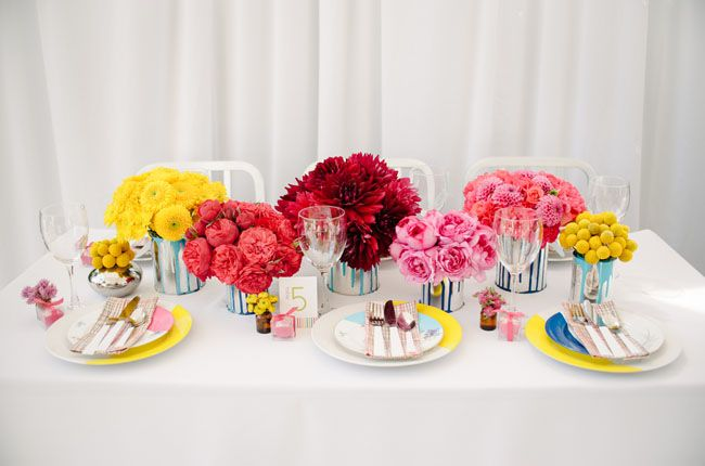 flowers in paint cans for centerpieces