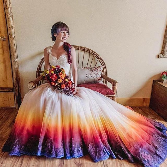 We're not surprised that the dip dye wedding dress trend is going strong - there are just so many ways a bride can get creative with it! We're loving bride and artist Taylor Ann Art's DIY wedding gown airbrushed in the prettiest of sunset colours!