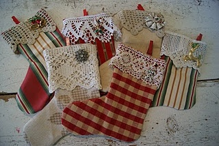 handmade miniature stockings embellished with vintage lace and jewelry - http://www.cottageatleesburg.com/2010/12/its-that-time-of-year.html