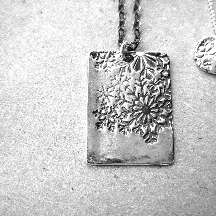 #Square #snowflake sterling #silver #necklace by #Designer Leisa Davies Like #snowflakes no two if these will ever be the same. This necklace features a #rustic snowflake pattern. This #snowy #charm measures approximately 15mm across and hangs from an 18″ sterling silver chain. My square snow charm is made entirely from #recycled Fine Silver (.999FS) _________________________________________________________________________ [...]