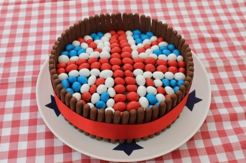 Easy chocolate cake - cadbury's fingers and M's. Union Jack flag for Jubilee birthday!