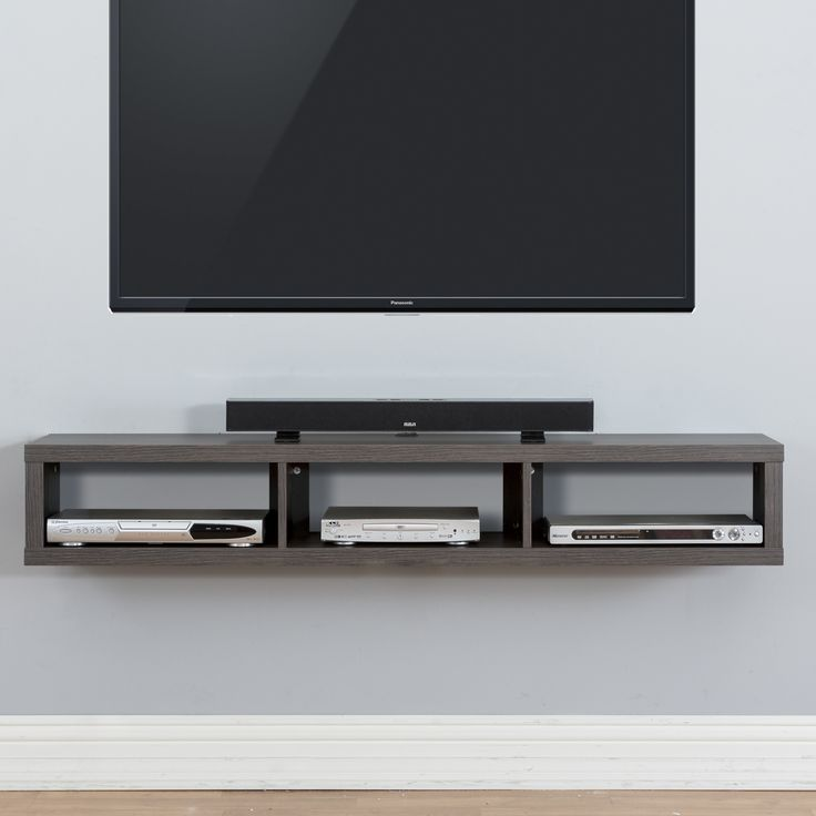 "Features: -Walnut finishes. -Holds 3 audio/video components and a sound bar to compliment a wall mounted television up to 80"". -Holds up to 120 Lbs. and comes with mounting hardware for standard wo"