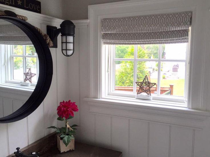 white cottage custom classic operable roman shade in geometric greige fabric