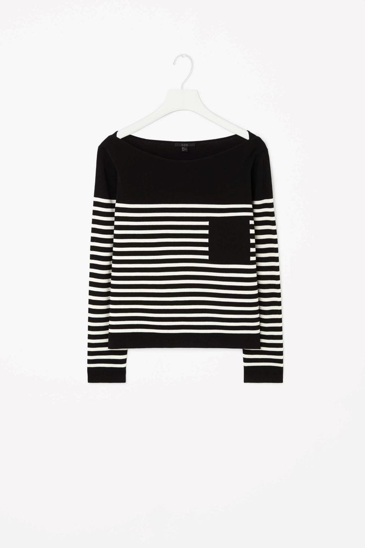 Made from finely knitted cotton-mix, this striped jumper has clean, modern edges and a block-coloured panel on the chest to give the illusion of a pocket. Slightly cropped, it is a wide, boxy fit with a boat neckline, long sleeves and a crossover detail on each shoulder.