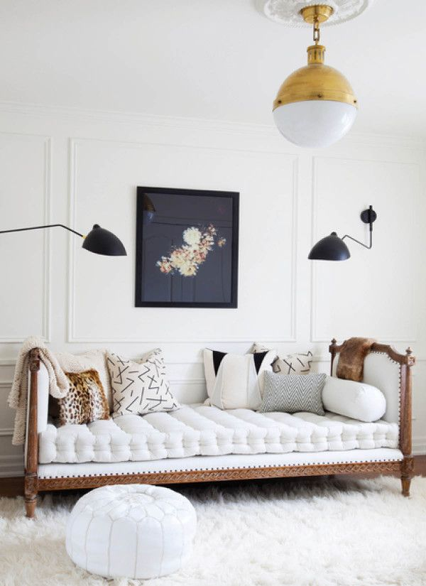 A white living room with and antique