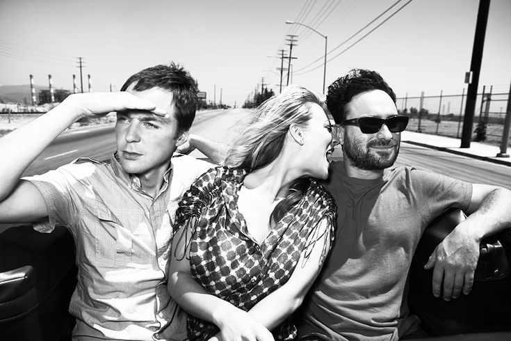 Sheldon, Penny, and Leonard looking decidedly un-nerdy.