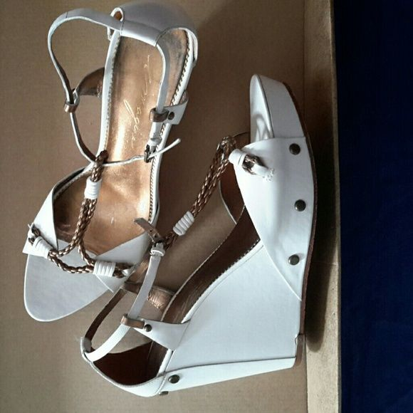 """VINCE CAMUTO IMAGINE WHITE  WEDGE SANDALS Pre owned shoes in good condition  leather sandals from Imagine Vince Camuto line. ORIGINALLY $ 178  Size US 7 M with adjustable straps and platform. Heel height is 4 """" with 1"""" platform.  Style is called """"Urali"""".  Studded detail around the back of heel and at the base of shoe.  Leather upper; Leather sole; Leather lining  Metal studs add stability and decoration  Adjustable ankle strap with buckle closure  """" URALI """" is made in BRAZIL Vince Camuto…"""