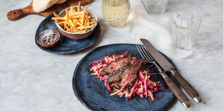 Blogger Regula Ysewijn offers up a great steak dinner idea, using marinated beef skirt in this easy steak recipe. Served with crispy fries and coleslaw, this impressive recipe is perfect for a dinner party.