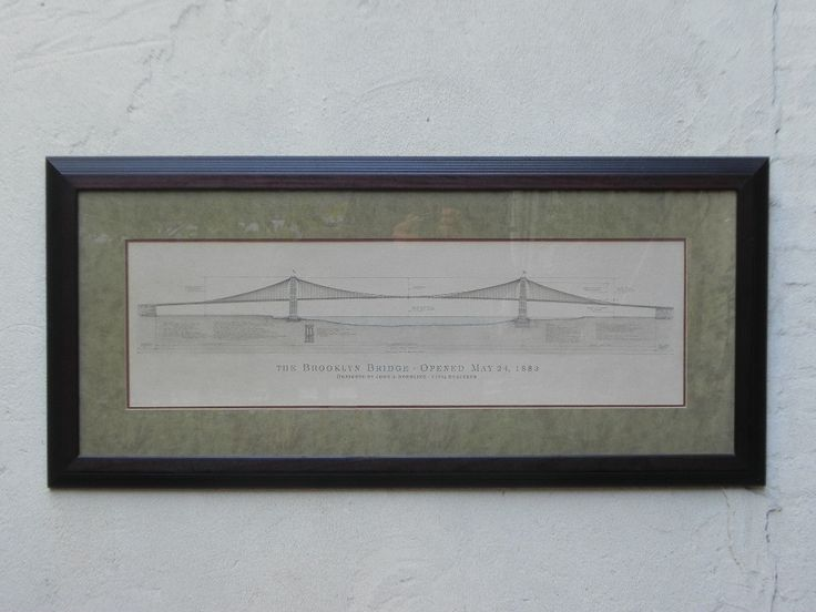 Classy and understated framed print of the original Brooklyn Bridge architect's drawings. Framed by Bombay, back when Bombay existed and did this sort of thing, this piece is perfect for the den or of