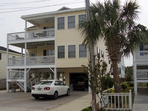 ust a few blocks from the white sandy beaches and majestic Atlantic Ocean is Cotton Patch, a North Myrtle Beach vacation rental that sleeps up to 18 people. Cotton Patch is a two-story North Myrtle Beach rental on stilts. With six bedrooms and five full baths, this North Myrtle Beach house rental will host the masses.
