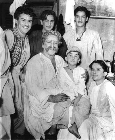 The Kapoor clan- Raj Kapoor and Shammi Kapoor (standing); Prithviraj Kapoor  with Randhir Kapoor on his lap and Shashi Kapoor (sitting)