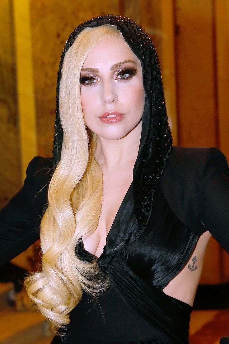 Lady Gaga gave her best Donatella Versace impression with long, curled hair and a bronzy, smoky eye.