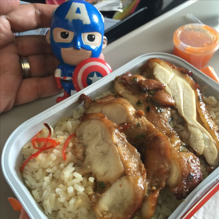 Menu : Uncle Chin's Chicken Rice from Air Asia airlines, route from Jakarta to Kuala Lumpur. with my mascot Captain America.