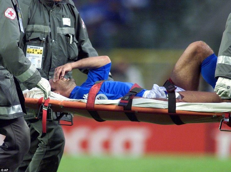 Conte is carried from the pitch on a stretcher after suffering a torn ankle ligament during Italy's game with Romania during Euro 2000