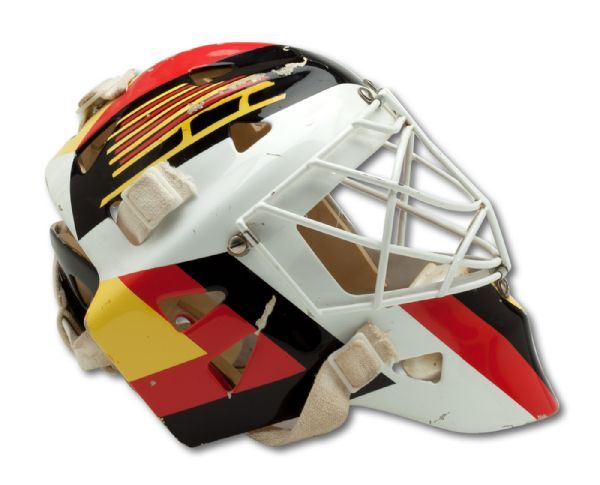 1993-94 KIRK MCLEAN AUTOGRAPHED VANCOUVER CANUCKS (STANLEY CUP FINALS) GAME WORN GOALIE MASK WITH STANLEY CUP FINALS PHOTO-MATCH (NSM COLLECTION)