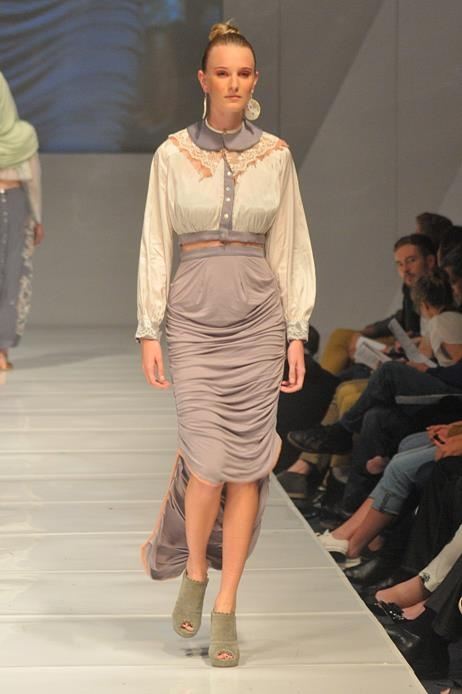 draped high waisted skirt with dipped hem paired with a cropped button up shirt and detachable collar