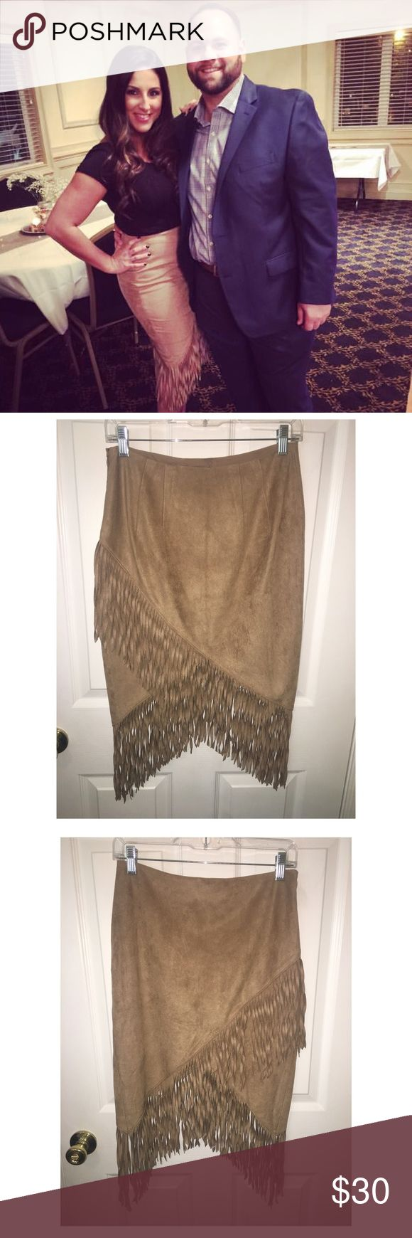 "FRINGE SKIRT Faux Suede Fringed Wrap Pencil skirt with ample, eight-inch fringe that swishes when you walk. Keep it simple and sexy with a shape-skimming ribbed sweater or go for a fully Southwestern vibe with a cami and denim jacket.  High waisted Hidden hook and zipper on side 8"" fringe embellishment Wrap hem; Lined Polyester/Spandex body; Polyester lining Machine wash Express Skirts Pencil"