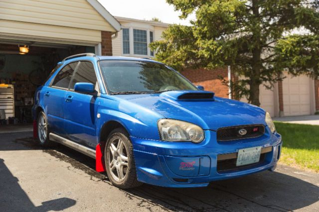please text or email me for details as i can't always answer the phone!!! for sale 2004 subaru impreza wrx wagon with sti front end conversion. rare sti blue color, 215k, 5 speed manual. everything on the car works. selling as is because of a crack in the windshield. passed safety and e-test less than a year ago. engine, transmission, and body are solid! asking for $7300 obo, s