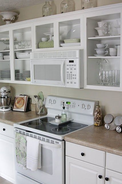 15 Ways To Update Your Kitchen On A Dime. Open Cabinet ...