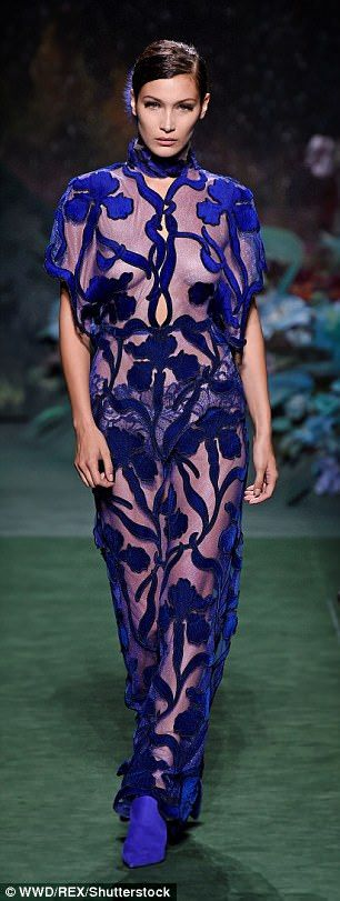 Catwalk: Model of the minute Hadid, 20, rocked a loose and floaty, blue floral jumpsuit on...