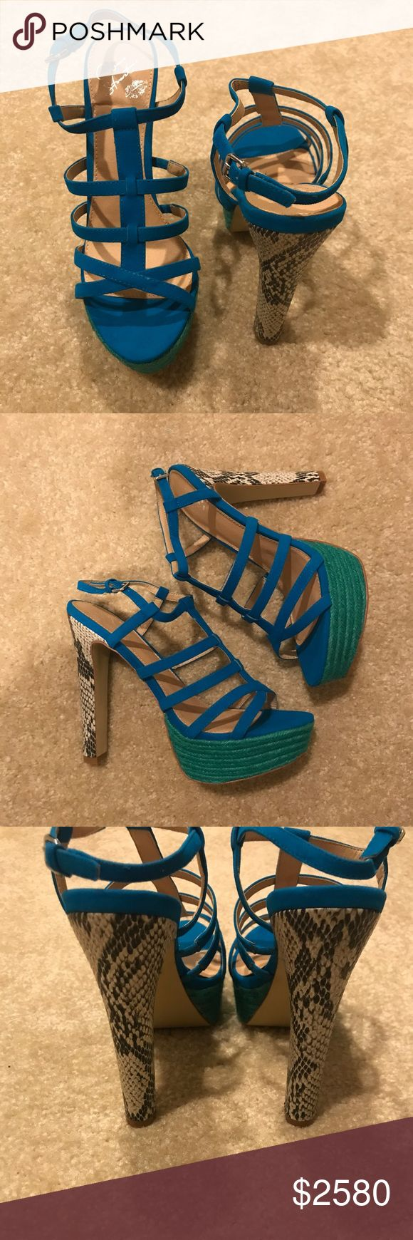 "NWT Colin Stuart Strappy Heels In Box - Size 8.5 BRAND NEW IN BOX, NEVER WORN Colin Stuart For Victoria's Secret Strappy Platform Heels -  These gorgeous sandals have electric blue straps in a cage-like design with an adjustable strap with silver buckle at ankle. Heel has a faux snakeskin pattern and teal platform is woven with a braided design.  Size 8.5  Heel Height: 5.5"" Platform: 1.5"" Colin Stuart Shoes Sandals"