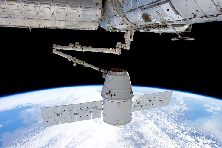 The dragon spacecraft was the first commercial spacecraft to be succesfully recovered from orbit. Here it's pictured being berthed to the International Space Station during the third trip of a dragon spacecraft to mankind's biggest outpost in space.
