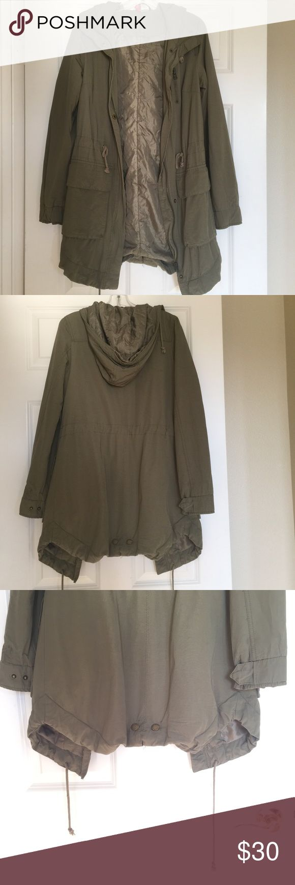 H&M winter coat This is a long winter coat. It is army green, has strings to pull it in tighter for warmth at the bottom and also strings to pull it in at the waist. It zips down but also buttons over the zipper. Two big pockets and a hood Divided Jackets & Coats