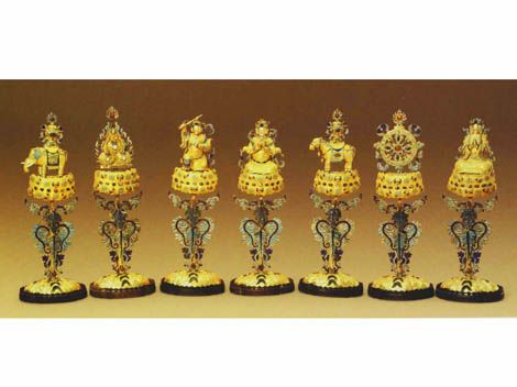 Seven Buddhist treasures decorated with gold and inlaid with precious stones