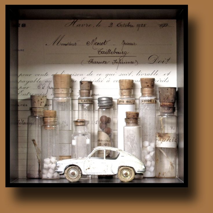 Belle brocante art. Vintage French invoice. Glass vials with pills, specimens, and bird bones. Die cast vintage French auto.