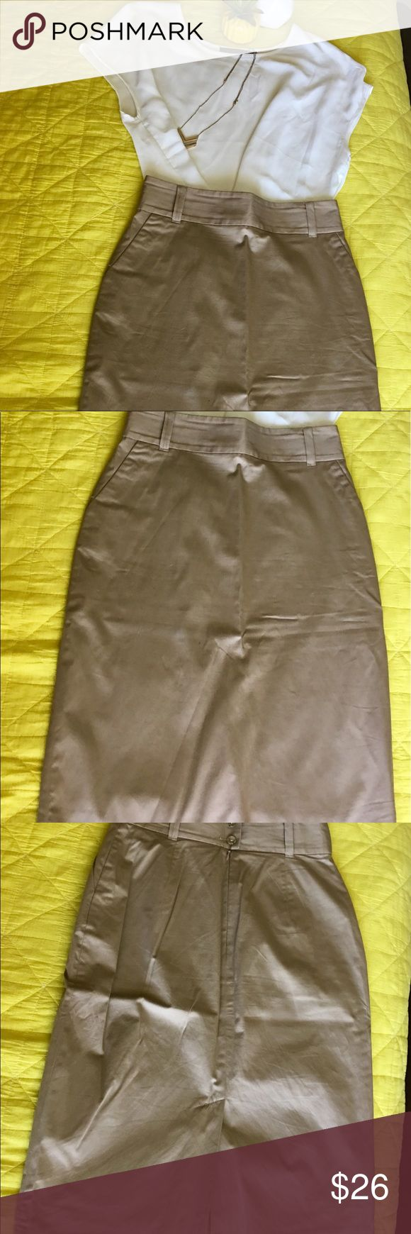 Banana Republic Pencil Skirt over the knee tan Banana Republic Pencil Skirt over the knee dark khaki/ tan. Great condition! Be mindful no lowballing! Banana Republic Skirts Pencil