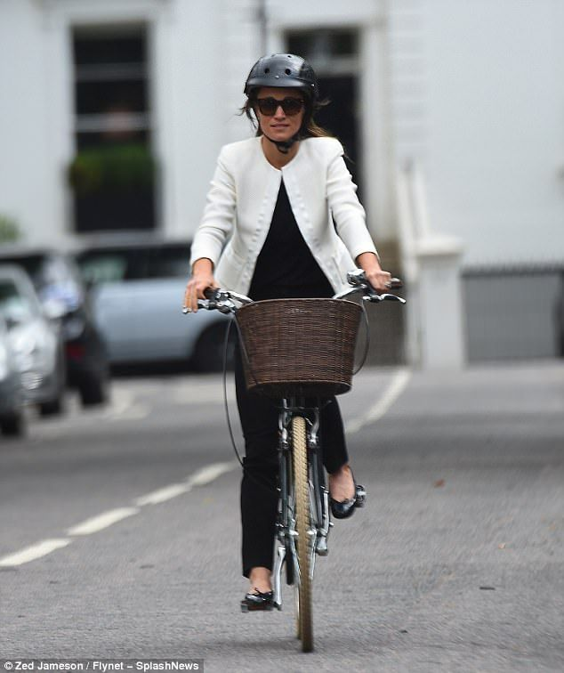 Pippa was chic in a black top and jeans, flat black ballet pumps and a cropped white blaze...