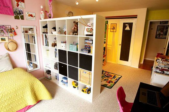 For kids who share a room, putting a shelf in the middle of the room or painting each side a different color is a great way to help give each kid their own space. This family even added a pegboard to one side of the shelf. What a great idea for more storage!