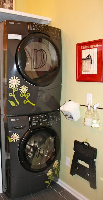 The whole laundry room is fabulous, but I especially love the decals on the washer & dryer!