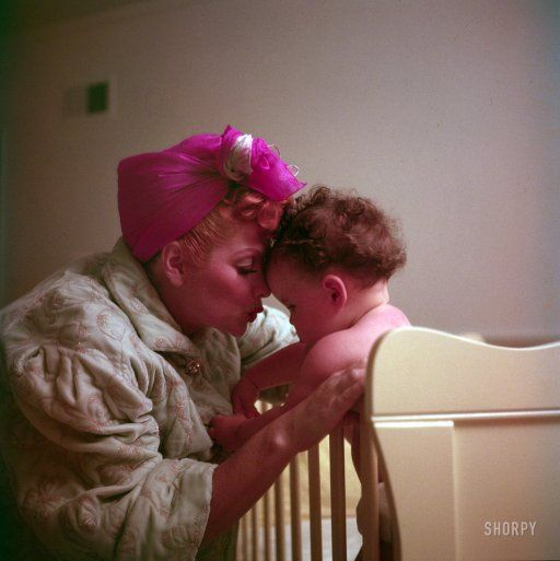 "1952. ""Lucille Ball and daughter Lucie Arnaz nestling together at home."""