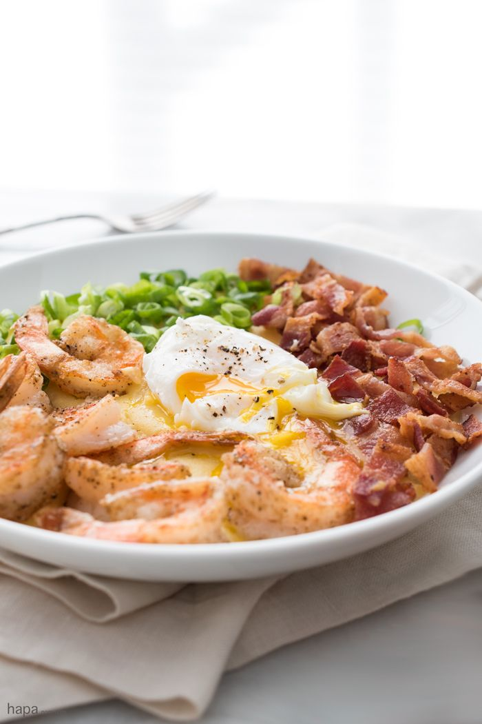 This Salt & Pepper Shrimp and Grits makes a great meal anytime of day! Wether you want a big breakfast, a hearty dinner, or any meal in between; lightly crispy salt & pepper shrimp over cheesy grits, garnished with crispy bacon, scallions, and topped with a creamy poached egg is a dish that will keep you going!
