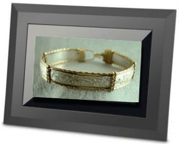 electronic-picture-frame-with-jewelry-photos-21269939  Note: using an electronic photo frame to show jewelry at shows, and tips on using a battery to power lights when no elec is available.