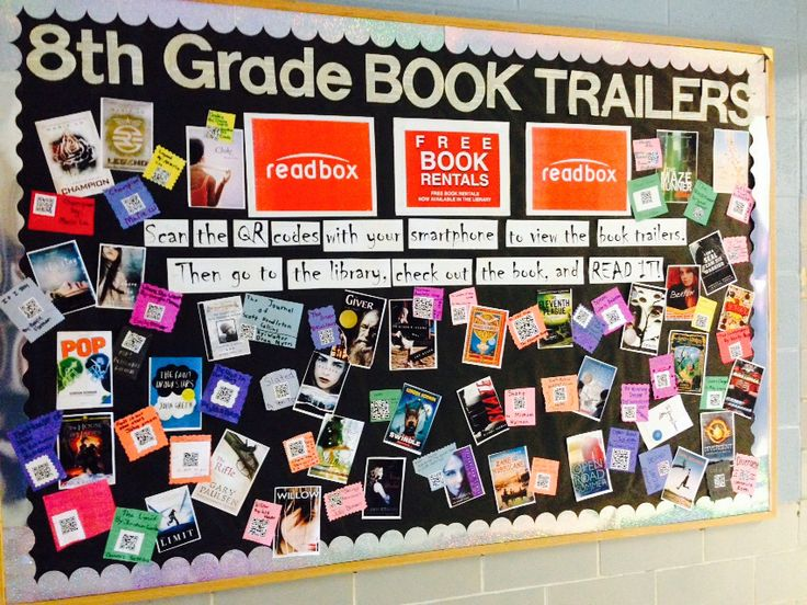 "Book trailer bulletin board: ""Readbox! Free Book Rentals at the library"" ""Scan the QR codes with your smartphone too watch the book trailers. Then go to the library, check out the book, and read!"""