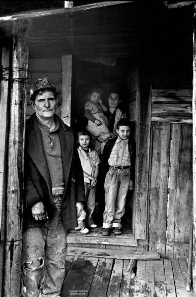Miner on porch with family in doorway, Wilder, TN.  Jack Corn Photography