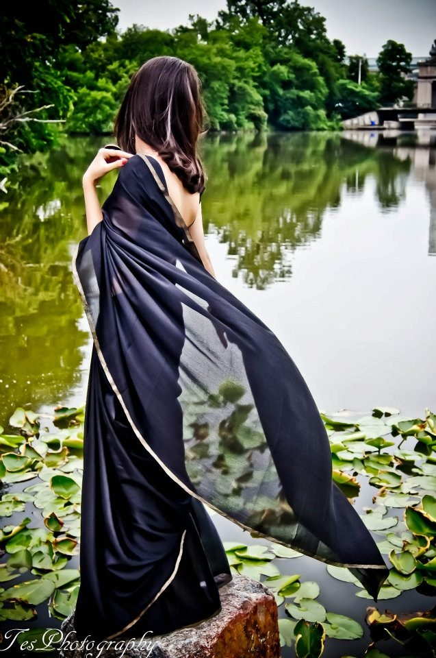 Simple and elegant black saree with thin gold border.