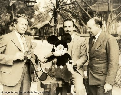 "From left: Captain Bernt Balchen, Walt Disney astride a wooden pony nicknamed ""Ham,"" and Sir Hubert Wilkins. The photo was taken at a Breakfast Club meeting, September 28, 1932."
