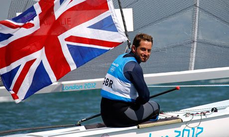 Ben Ainslie flies the Great Britain flag after winning the Finn class gold medal, his fourth successive Olympic gold.