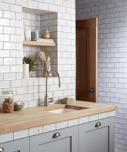 Vyne White™ Gloss Tile Topps Tiles. Like the idea of tiles under worktop, although just staged for the photo.