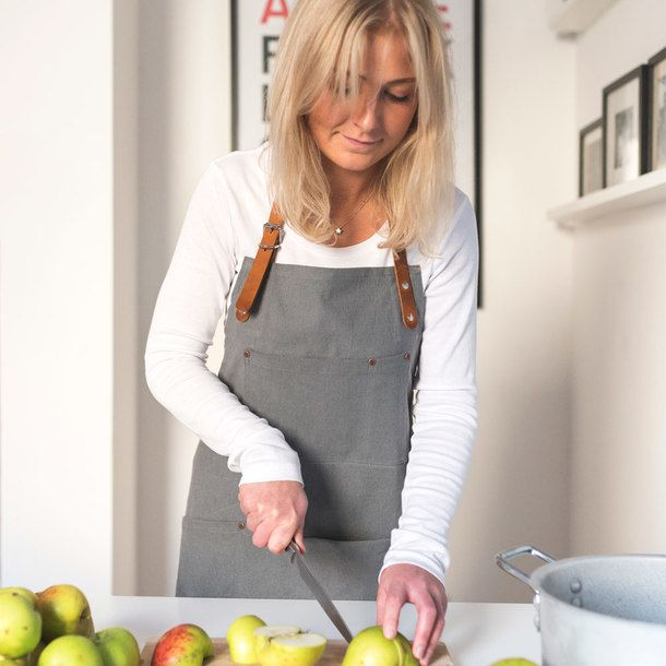 """Inspired by British heritage and tradition, Risdon & Risdon handcrafts """"heirloom piece aprons"""" — combining function, strength and style to be passed on to future generations.    They have a firm belief in the uncompromising quality and durability of their aprons, and give each of them a lifetime guarantee. Explore the full selection at waremakers.com"""