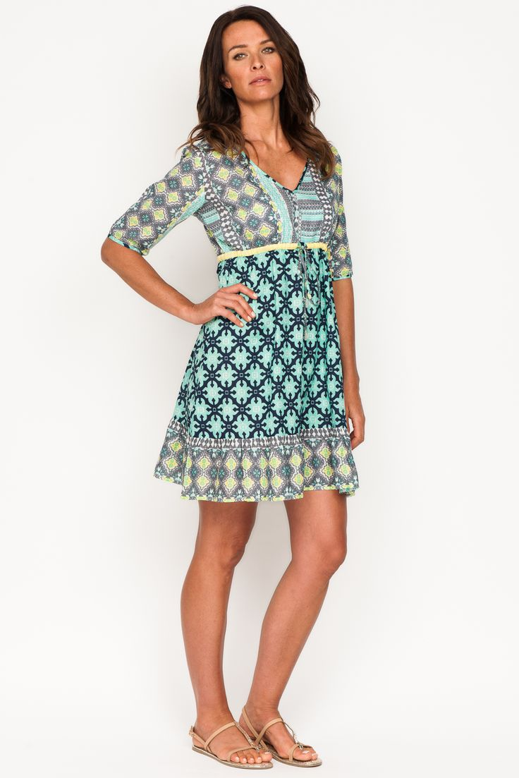 Above the knee dress with elbow length sleeves, under bust drawstring and hemline frill