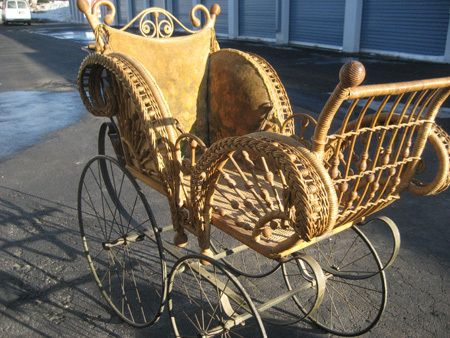"""Victorian era baby carriage or perambulator """"pram"""" there! It was made between the late 1880s-1898 and has its original upholstery and original stained rattan reed ball and stick framework and embellishments.  The wire wheels are indicative of an older piece, as is the parasol holder in the back by the handlebar.  But parasol is missing.  The Wicker Woman-Cathryn Peters-Angora, MN   http://www.WickerWoman.com/"""